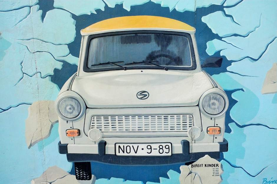 A Trabi painted on the East Side Gallery, the largest remaining part of the Berlin Wall still standing.